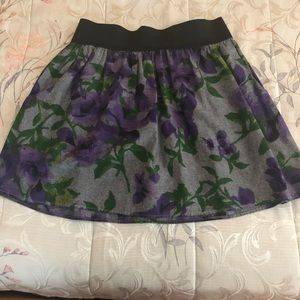 Mini skirt with purple flowers
